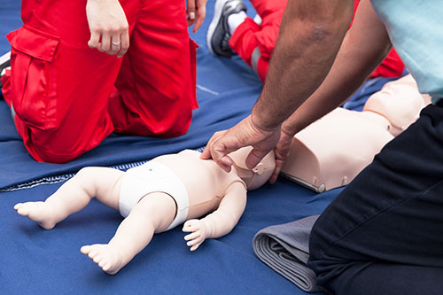 performing CPR on a baby actar